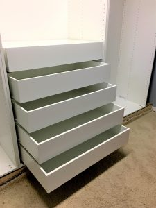 How to use Ikea PAX wardrobes, plus some crown molding and baseboard trim, to get an amazing custom look!